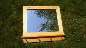 mirror with pegs