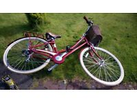 Red bicycle pendleton somerby with basket