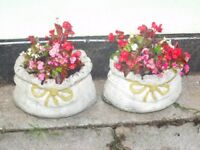 2 stone sack shaped garden planters with plants £15 each £25 the pair nice size pots