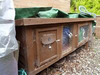 Five foot rabbit hutch for sale.