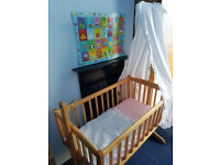 Used Clair de lune rocking cot with L drape Rod