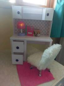 Girls playing doll dressing table with lamp and swivel chair