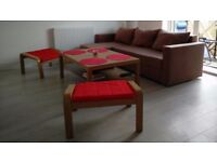 2x Ikea Poang oak effect footstool/seat with a red cover.