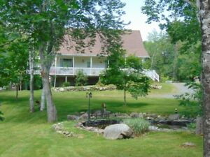 14.56 ACRES/WOODSTOVE/HEATED GARAGE/SHEDS/POND IN MCGEE LAKE
