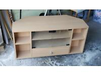 TV unit in light wood.