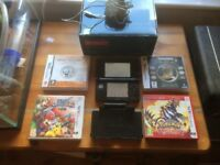 Black Nintendo 3DS with 4 games