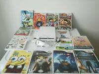 Nintendo Wii console in excellent condition with accessories and 13 games