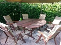 LARGE WOODEN GARDEN DINING TABLE WITH SIX CHAIRS FOR SALE