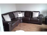 Brown leather corner sofa and large footstool