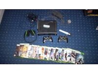 Xbox 360 120gb , 2 remote controllers, headphones, microphone, wifi connector and 20 games