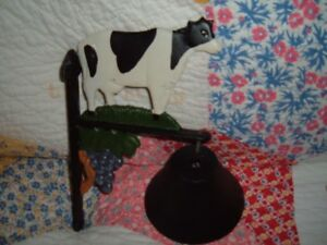 Wrought iron cow bell on bracket