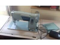 singer electric sewing machine in cabinet