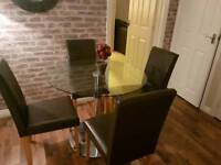 Round glass bistro table with 4 chocolate leather chairs