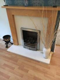 Beech wood mantle piece and conglomerate marble fire surround