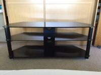 Large black glass TV stand, 3 tier, 47 inch width