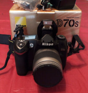 Mint Nikon D70s DSLR w/ 3 year warranty and lens.