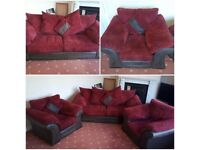 Three piece suite in good condition. Burgundy covers and brown base.