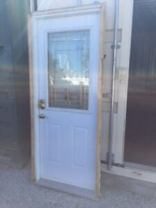 DOOR AND FRAME MADE BY MDL- EXTERIOR, STEEL; NIAGARA BRASS WINDO