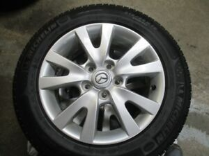 Mazda  16 in. Mag rims and Michelin X-Ice winter Radial Tires