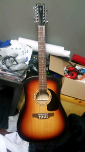 12 string Simon and Patrick acoustic guitar