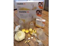 Medela swing breastpump and extra