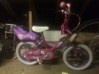 "Girls 14"" ralliegh Molly bike, with stabilisers."