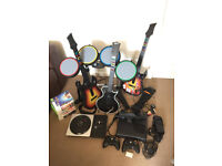 Xbox 360 with kinect, 3 guitars, drum, 2 controlers, DJ and 16 games