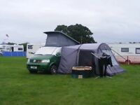 Green T5 campervan and awning