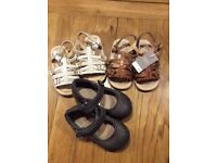 Three pairs of infant size 4 shoes