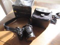 Nikon Coolpix L310 Digital Camera and tripod