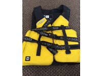 Wetsuit and two life jackets for sale