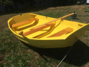 The Yellow Dipper, a hand crafted pram / rowboat / dinghy!