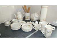 Collection of Harvest Pattern Kitchenware from Marks and Spencers. 26 pieces plus wooden utensils.