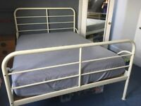 Double Bed, Metal Frame with a Deep Firm Mattress, both from Ikea