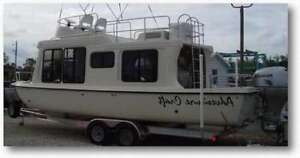 I AM LOOKING TO BUY A  SMALL HOUSE BOAT