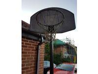 Freestanding basket ball net.