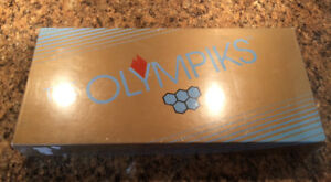1987 Olympiks Game.  New In Seal (ripped)