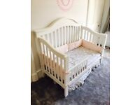 Beautiful toddler cot with side buffers and Simmons mattress in pristine condition