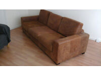 Beautiful brown leather sofa for sale.