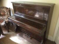 Antique solid wood piano