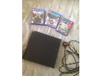 Sony PS4 500GB w/3 games, cables, no controller