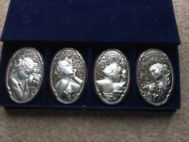 Four seasons 'silver' plaques