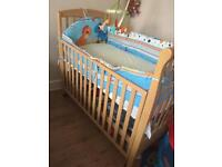 Baby cot bed with bumper and baby activity