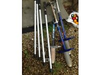 Three pogo sticks and two pairs of stilts.