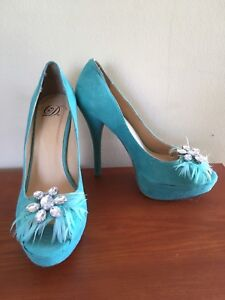 Teal heels w/ feathers and jewels