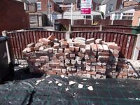 Bricks, some slabs,coping stones and hardcore. Used need clearing.