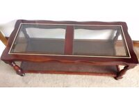 Glass top coffee table with magazine shelf