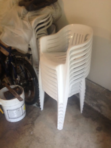 9 PLASTIC CHAIRS (LIKE NEW)--$4 EACH OR 9 FOR $30