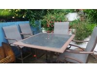 Patio Bar Table and Four large Chairs. Good quality, Heavy duty and durable.