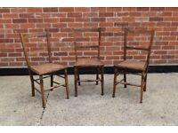 Set of three matching dark wood cane chairs